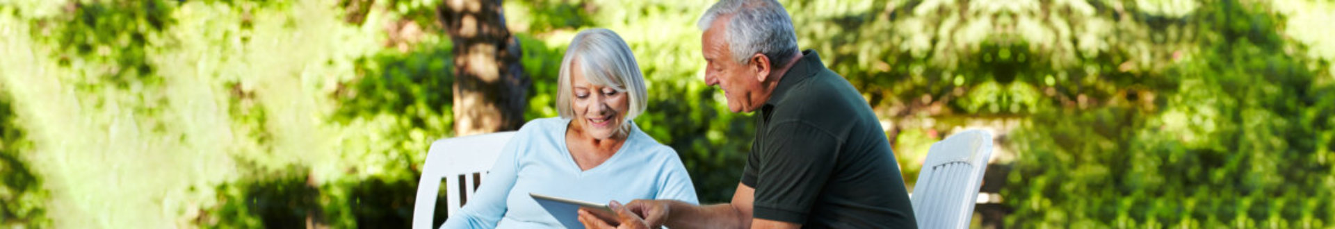 senior couple looking at a tablet